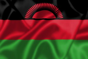 Malawi flag blowing in the wind. Background texture.