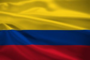 Colombia flag blowing in the wind. Background texture.
